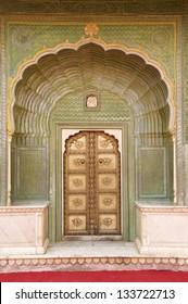 Green Doorway at Jaipur City Palace, Chandra Mahal, Jaipur, Rajasthan India. In courtyard Pitam Niwas Chowk. Green Gate, also called the Leheriya suggestive of spring and dedicated to Lord Ganesha.