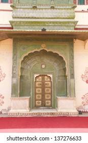 Green Doorway at Jaipur City Palace, Chandra Mahal, Jaipur, Rajasthan, India. In courtyard Pitam Niwas Chowk. Green Gate, also called the Leheriya suggestive of spring and dedicated to Lord Ganesha.