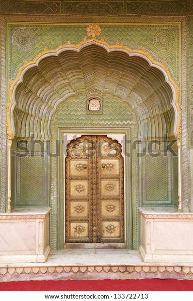 Green Doorway at Jaipur City Palace, Chandra Mahal, Jaipur, Rajasthan India. In courtyard Pitam Niwas Chowk. Green Gate, also called the Leheriya suggestive of spring and dedicated to Lord Ganesha.