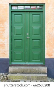 Green double-door (wood) entrance to house, Danish design