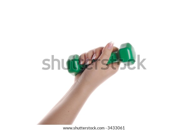 green dumbbell in hand isolated on white