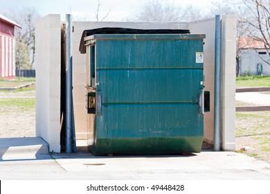 a green dumpster