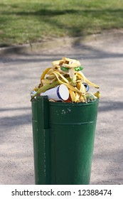 Green dust bin full of banana skins and other garbage