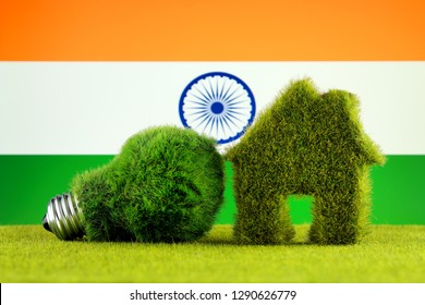Green eco light bulb, eco house icon and India Flag. Renewable energy. Electricity prices, energy saving in the household.