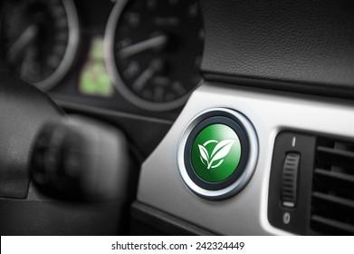 Green ECO mode button on a dashboard of a sportive car.