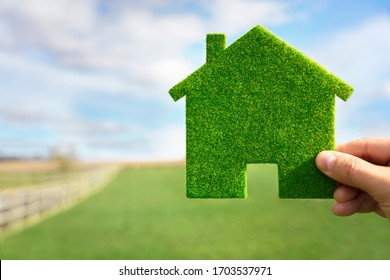 Green ecological house in empty field concept for construction and real estate - Shutterstock ID 1703537971