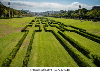 The green Eduardo VII park and terraces with a view of the cityscape of Lisbon in Portugal