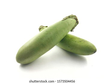 Green eggplant fruit isolated from a white background
