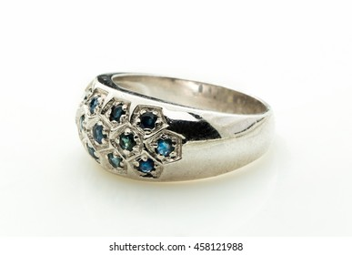 green emerald band ring on white background