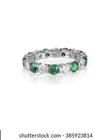 green emerald and diamond wedding band ring isolated on white