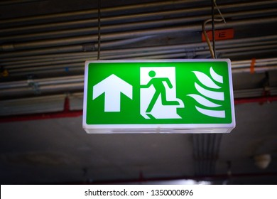 green emergency exit sign, fire exit
