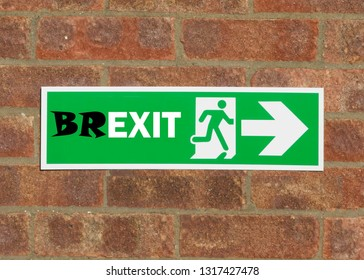 Green emergency exit sign that has been altered to a Bexit sign.