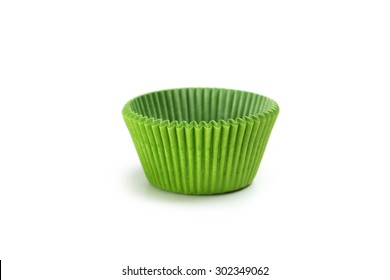 Green empty cupcake cases isolated on white