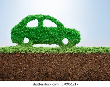Green energy car concept with grass in shape of a car
