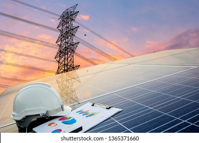 Green energy concept, Electricity station, Close up high voltage power lines at sunset. renewable energy concept with photovoltaic panels, Engineers calculate the cost.