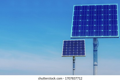 Green energy concept, Solar cell panel pole with blue sky on sunny day, Photovoltaic cell is an electrical device that converts the energy of light directly into electricity by the photovoltaic effect