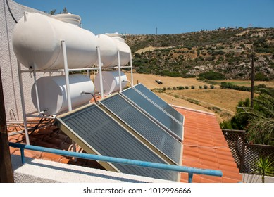 Green energy concept. Solar water heater on the roof of a house