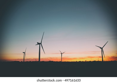 Green energy concept. Wind turbine generator in Denmark. Retro image