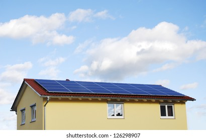 Green Energy - Electricity generation with solar panels on the roof