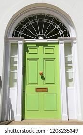 green entrance door of historic upmarket residence