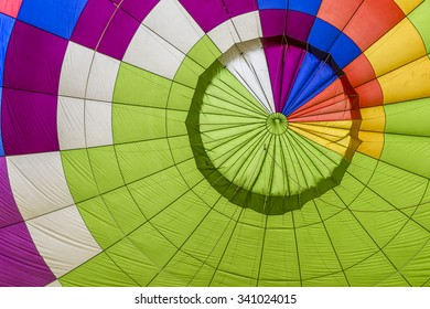 Green envelope of the hot air balloon with yellow, blue, orange, white and violet strips