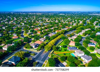 Green escape luxury living Round Rock , Texas , USA Suburb growing outside of Austin high aerial drone view green end of summer colorful morning Millions of Homes vast Neighborhood Suburbia