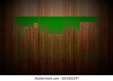 green evacuation door sign painted on vertical glossy wood planks texture background