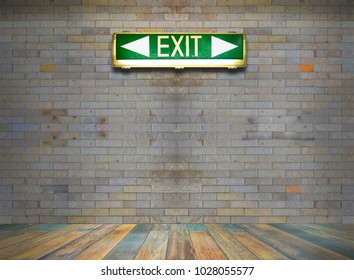 Green exit old sign on brick wall