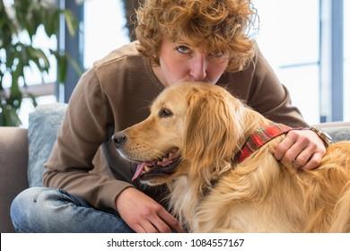 Green eye woman kissing her dog and looking at camera