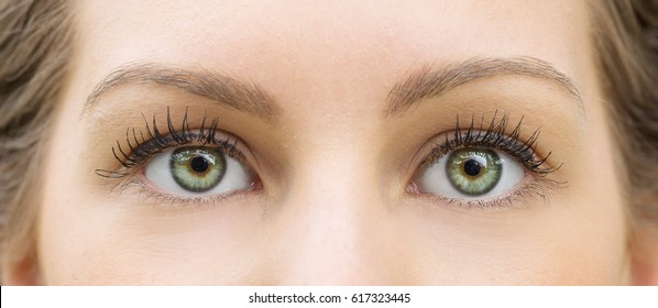 Green eyes of beautiful young girl