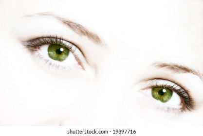 Green eyes on white background