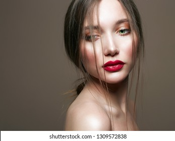 Green Eyes young beautiful young woman. Beauty sensual girl with red lips make-up.