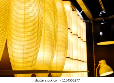 The green fabric lampshade at the magazine. colorful, decorative, electrical, furniture, illumination, lamp, lampshade, style, textile, abstract background, hanging lamp, interior design