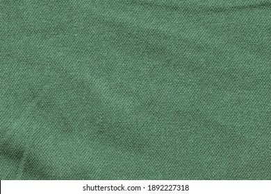 Green fabric texture for clothing.