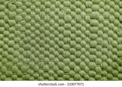 Green fabric texture. coarse canvas background - closeup pattern