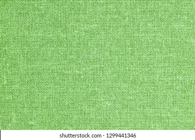 Green fashion background. Closeup, detailed fiber canvas pattern background.