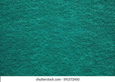 Green felt background.