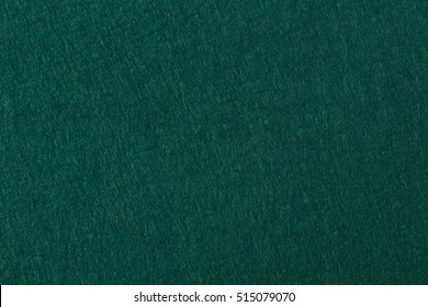 Green felt background. Useful for poker table or pool table surface. High resolution photo.
