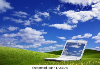 Green Field and a laptop