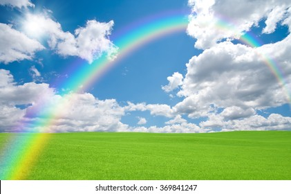 Green field and rainbow