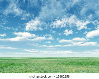 Green field and sky with white fluffy clouds