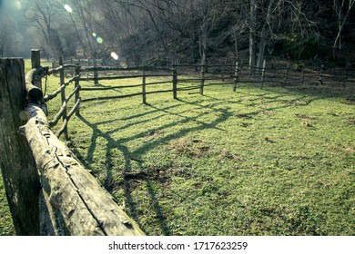 green field surrounded by wooden fence