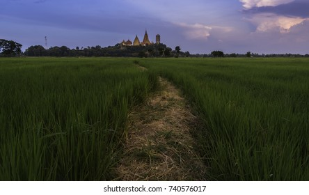 Green field with temple background , WAT KAO TAM SUA Karnjanaburi Thailand
