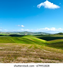 Green fields and farmlands in Tuscany. Rural countryside landscape in Italy