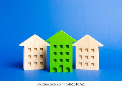 Green figure of a residential building stands out among the rest of the houses. Search for the best option to buy an apartment among the choices. High quality and convenient location of the property.