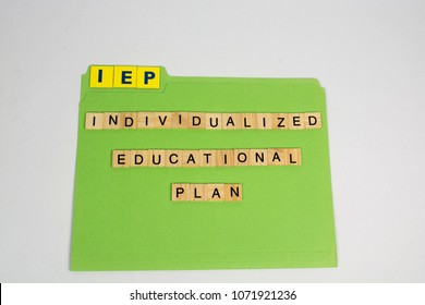 "A green file folder has the letters IEP which is an acronym for the phrase ""individualized educational plan"". The IEP is a plan used to help assist students with special needs."