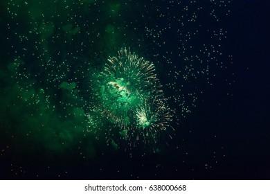 Green firework in night sky