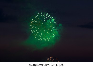 Green Fireworks in the Evening Sky