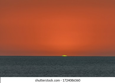 The green flash at sunset over the Pacific.