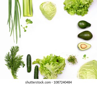 green flat lay  organic concept with dill, avocado, cucumber, cabbage, bow, celery, salad, and microgreen sprout isolated with shadow on white background and empty space for text.